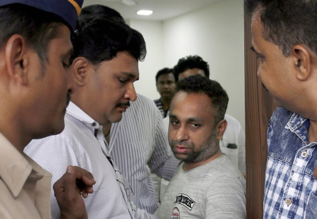 Bookie Sonu Jalan, who allegedly threatened Bollywood actor Arbaaz Khan over non-payment of money lost in betting on IPL matches, after being arrested by the police, in Thane. PTI Photo *** Local Caption ***