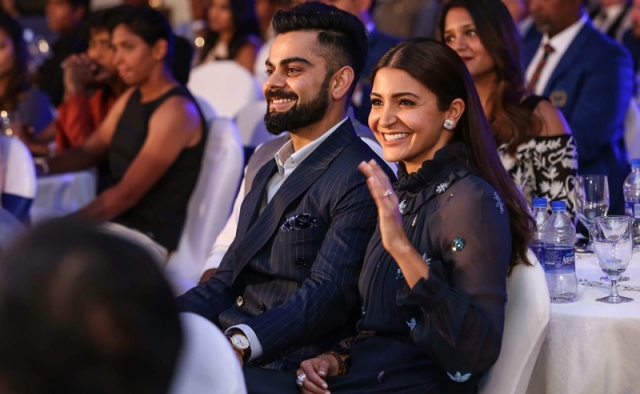 Indian cricket captain Virat Kohli with his wife and Bollywood actor Anushka Sharma during the 6th M A K Pataudi Memorial Lecture and BCCI Awards, in Bengaluru. PTI Photo/BCCI