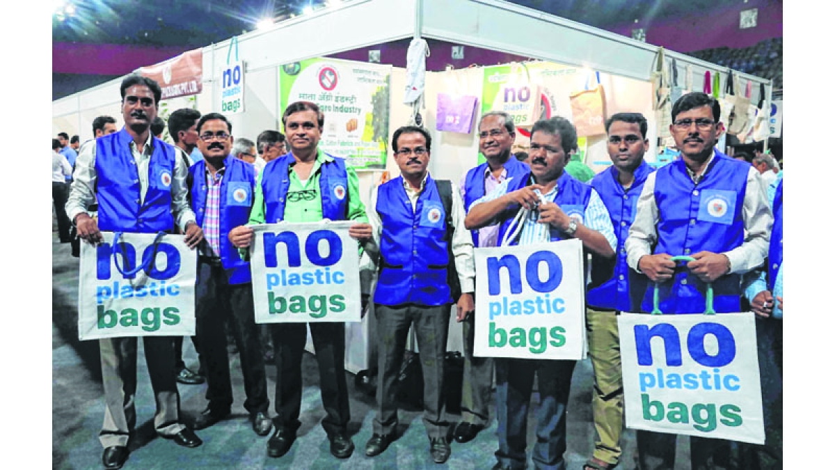 """Mumbai: State Government & MCGM Call """"Plastic Ban"""" from June 23 on occasion """"Plastic Ban Campaign"""" on cloth bags etc exhibition come sale stall in one cloth carry bag stall on  peoples shopping have rush and  State Environment Minister, Ramdas Kadam and MP, Arvind Sawant visit at NSCI, Worli, in Mumbai on Friday, June 22, 2018. (Photo by Bhushan Koyande)"""