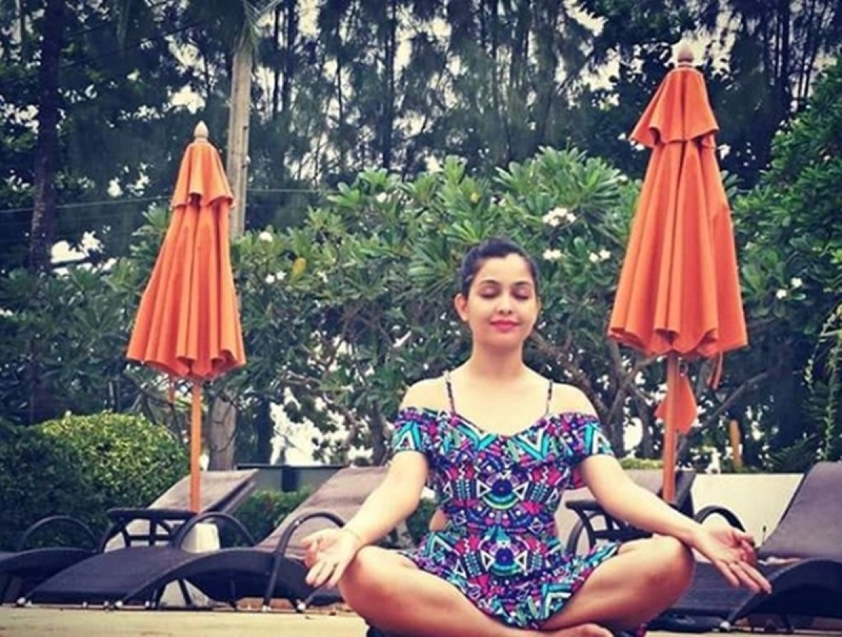 You won't believe who this famous TV actress doing Yoga in gorgeous swim wear is!
