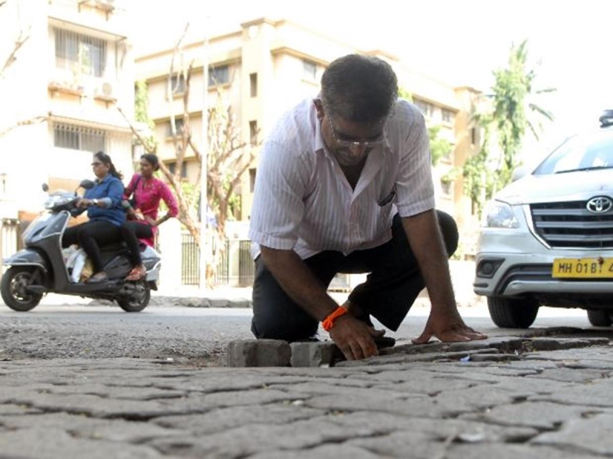 Mumbai man fills 556th pothole to mark his 16-year-old son's death