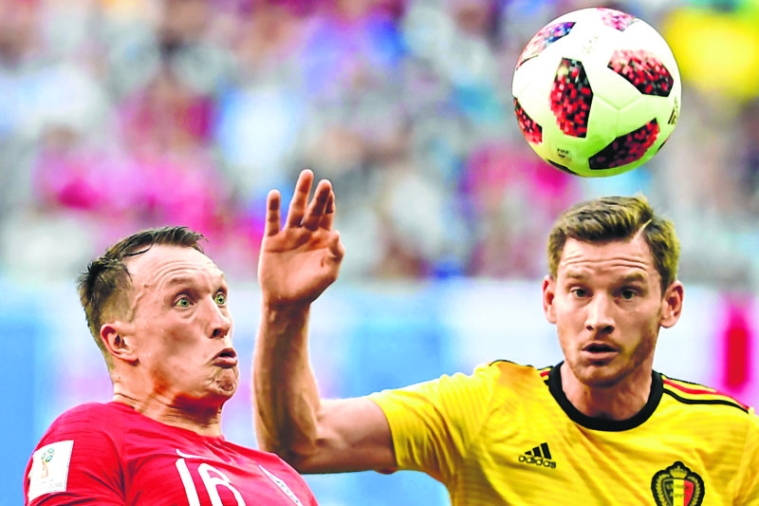 England's defender Phil Jones (L) eyes the ball with Belgium's defender Jan Vertonghen during their Russia 2018 World Cup play-off for third place football match between Belgium and England at the Saint Petersburg Stadium in Saint Petersburg on July 14, 2018. / AFP PHOTO / Giuseppe CACACE / RESTRICTED TO EDITORIAL USE - NO MOBILE PUSH ALERTS/DOWNLOADS