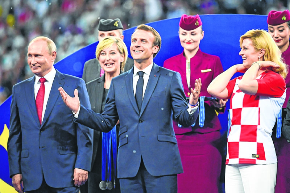 Macron cheers from the stands — then 'dabs' in the changing room