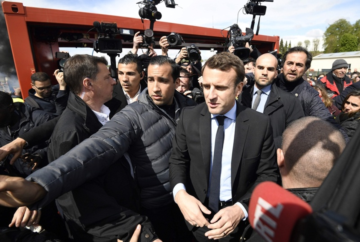 French President Emmanuel Macron orders office reorganisation over protester beating row