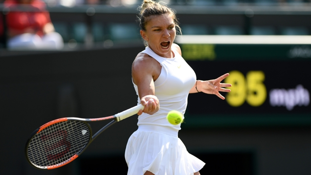 Romania's Simona Halep returns against China's Zheng Saisai during their women's singles second round match on the fourth day of the 2018 Wimbledon Championships at The All England Lawn Tennis Club in Wimbledon, southwest London, on July 5, 2018. / AFP PHOTO / Glyn KIRK / RESTRICTED TO EDITORIAL USE