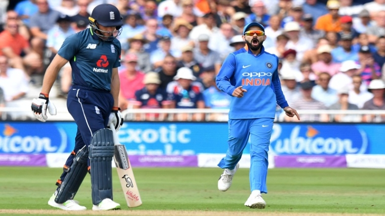 India's captain Virat Kohli (R) celebrates as England's Jos Buttler (L) is caught by India's MS Dhoni for 53 during the One Day International (ODI) cricket match between England and India at Trent Bridge in Nottingham central England on July 12, 2018. / AFP PHOTO / Anthony DEVLIN / RESTRICTED TO EDITORIAL USE. NO ASSOCIATION WITH DIRECT COMPETITOR OF SPONSOR, PARTNER, OR SUPPLIER OF THE ECB
