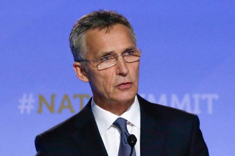 NATO Secretary General Jens Stoltenberg addresses a press conference on the second day of the North Atlantic Treaty Organization (NATO) summit in Brussels on July 12, 2018.  / AFP PHOTO / Aris Oikonomou