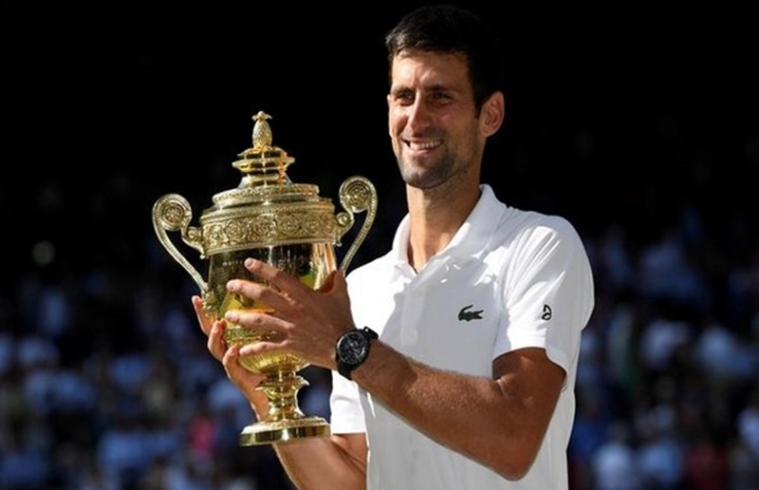 Tennis - Wimbledon - All England Lawn Tennis and Croquet Club, London, Britain - July 15, 2018  Serbia's Novak Djokovic celebrates with the trophy after winning the men's singles final against South Africa's Kevin Anderson   REUTERS/Tony O'Brien