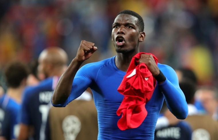 SAINT PETERSBURG, RUSSIA - JULY 10:  Paul Pogba of France celebrates following his sides victory in the 2018 FIFA World Cup Russia Semi Final match between Belgium and France at Saint Petersburg Stadium on July 10, 2018 in Saint Petersburg, Russia.  (Photo by Alexander Hassenstein/Getty Images)
