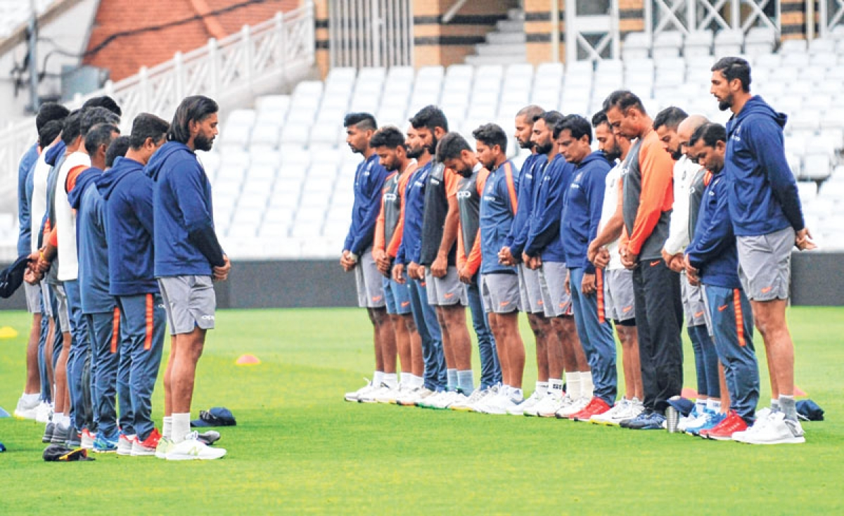 <strong>India players observe a minute of silence in tribute of former captain Ajit Wadekar before the nets session at Trent Bridge on Thursday.</strong>