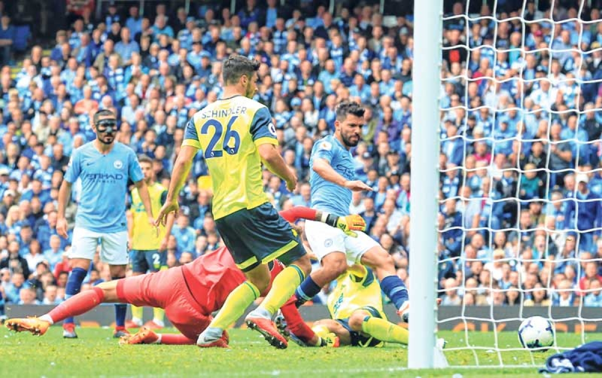 Sergio Aguero bags treble as rampant Man City thrash Huddersfield 6-1