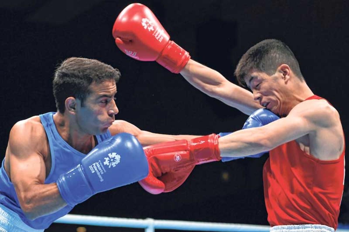 Asian Games : Boxers Vikas Krishan and Amit Panghal in semis; Sarjubala Devi, Dheeraj Rangi exit