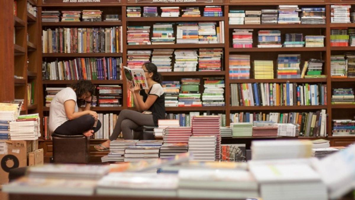 kitab khana: Readers are immersed in their respective books at Kitab Khana, Fort