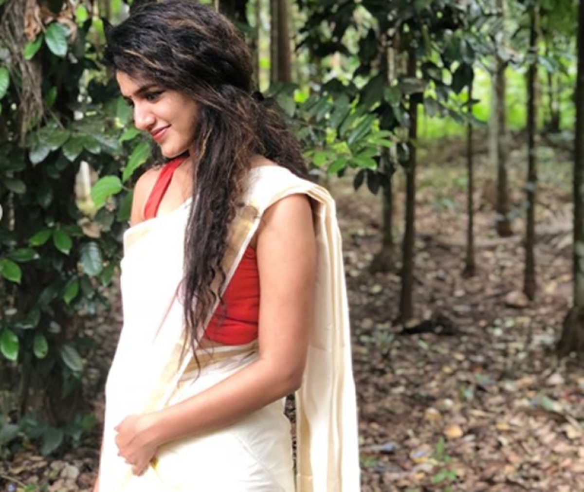 See Pics: Wink queen Priya Prakash Varrier's traditional white and golden saree look will drive you crazy