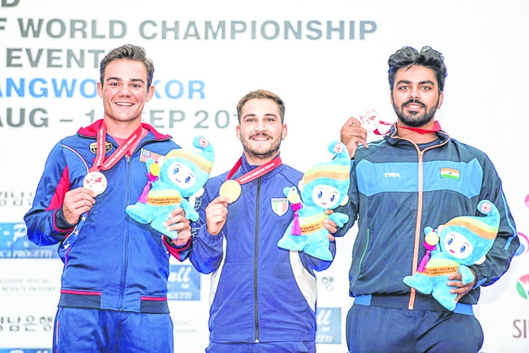 CHANGWON - SEPTEMBER 11: (L-R) Silver medalist Nic MOSCHETTI of the United States of America, Gold medalist Elia SDRUCCIOLI of Italy and Bronze medalist Gurnihal Singh GARCHA of India pose with their medals after the Skeet Men Junior Final at the Changwon International Shooting Range during Day 10 of the 52nd ISSF World Championship All Events on September 11, 2018 in Changwon, Republic of Korea. (Photo by ISSF Photographers)