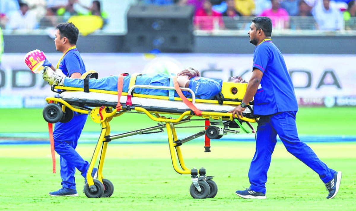 Indian cricketer Hardik Pandya is carried on a stretcher after getting injured during the one day international (ODI) Asia Cup cricket match between Pakistan and India at the Dubai International Cricket Stadium in Dubai on September 19, 2018. (Photo by Ishara S. KODIKARA / AFP)