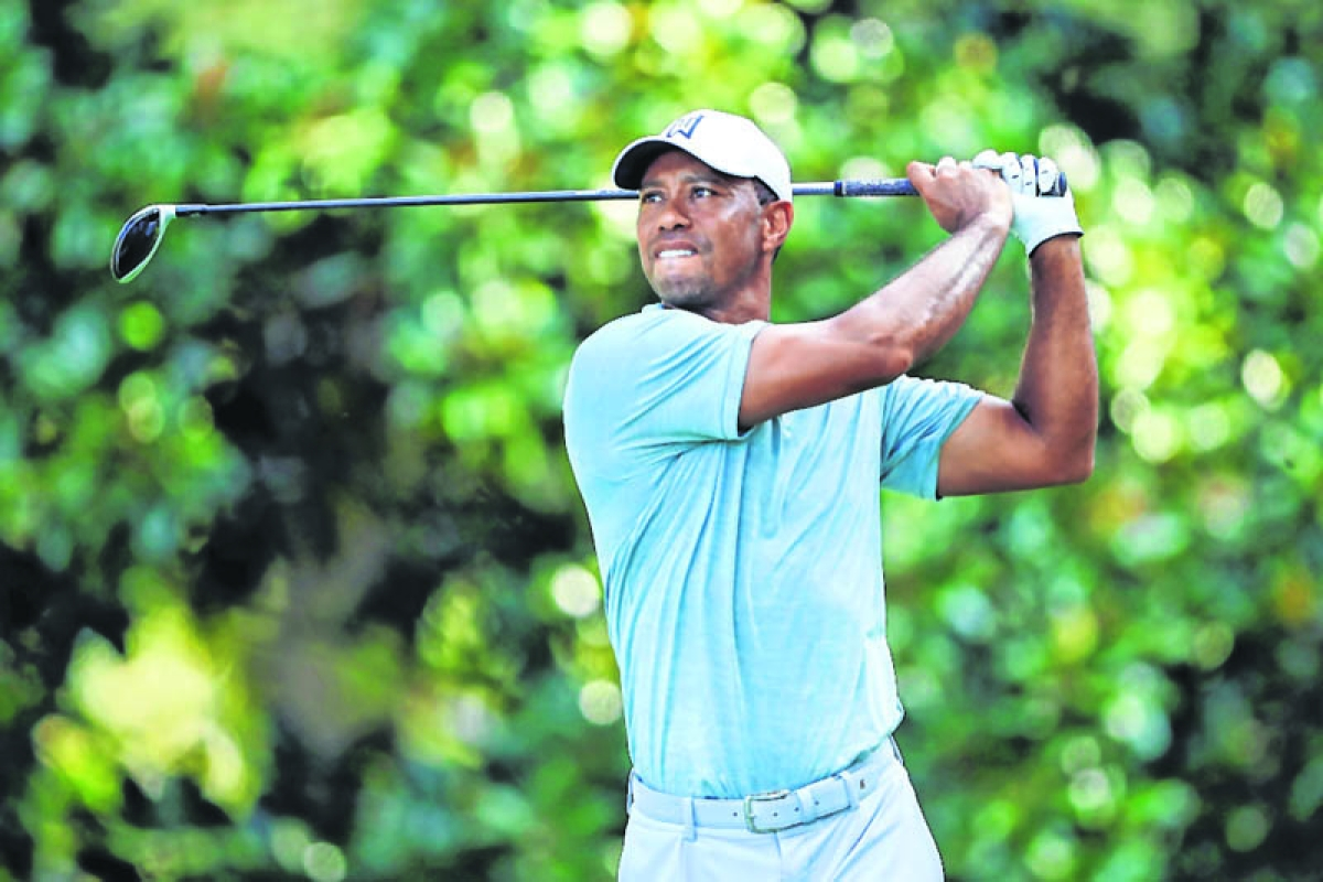 Woods maintains share of the lead