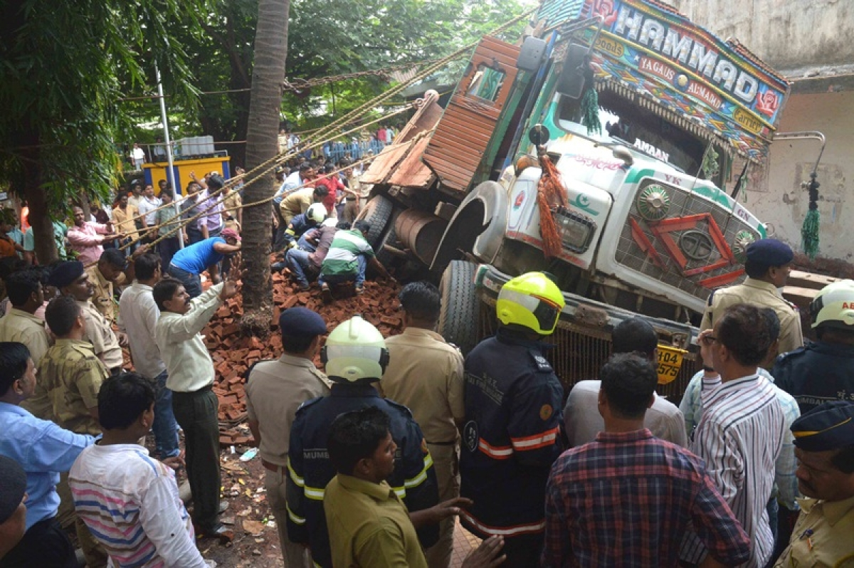 Mumbai: Truck gets stuck in manhole, overturns