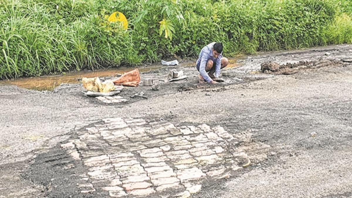 Gandhigiri Act: What does it take to fill potholes? 12 good men