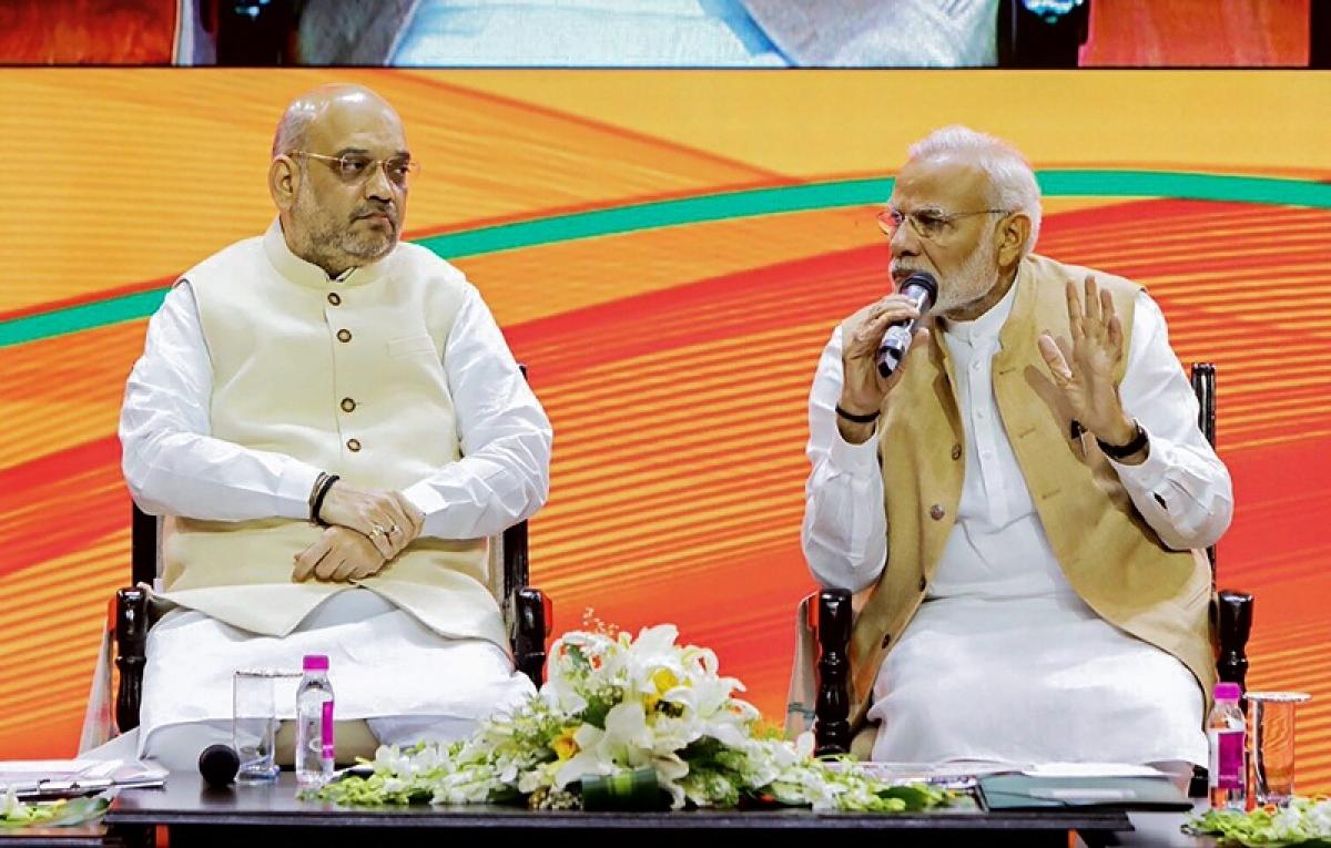 Signal Amit Shah is political 'heir' his 'sarthi'