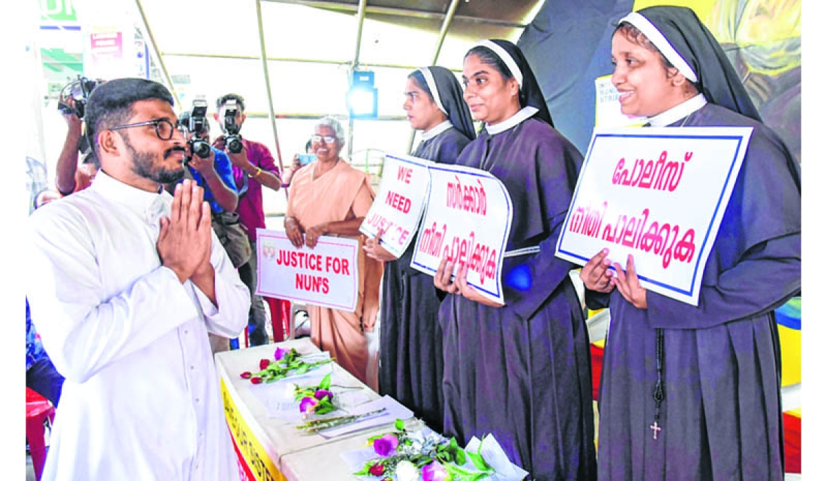 Kochi: Priests come forward to support nuns as they protest against the delay in action on a Roman Catholic church bishop, who is accused of sexually exploiting a nun, in Kochi, Friday, Sept 14, 2018. (PTI Photo)  (PTI9_15_2018_000166B)