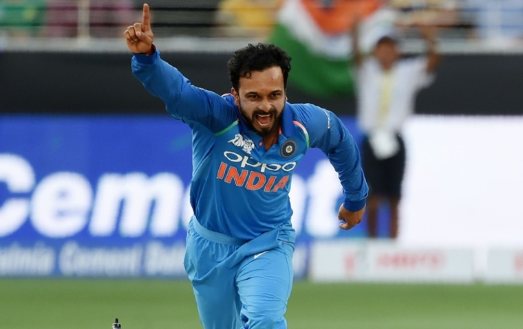 Kedar Jadhav celebrates after dismissing Pakistan batsman Shoaib Malik during the Asia Cup. (Photo by Ishara S. KODIKARA / AFP