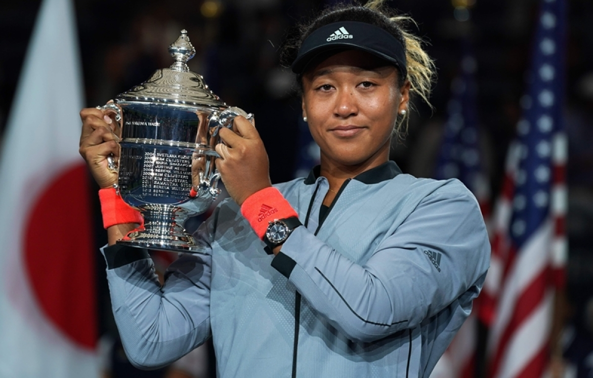 US Open Women's Single champion Naomi Osaka hold the trophy following her Women's Singles Finals match. Photo by TIMOTHY A. CLARY / AFP