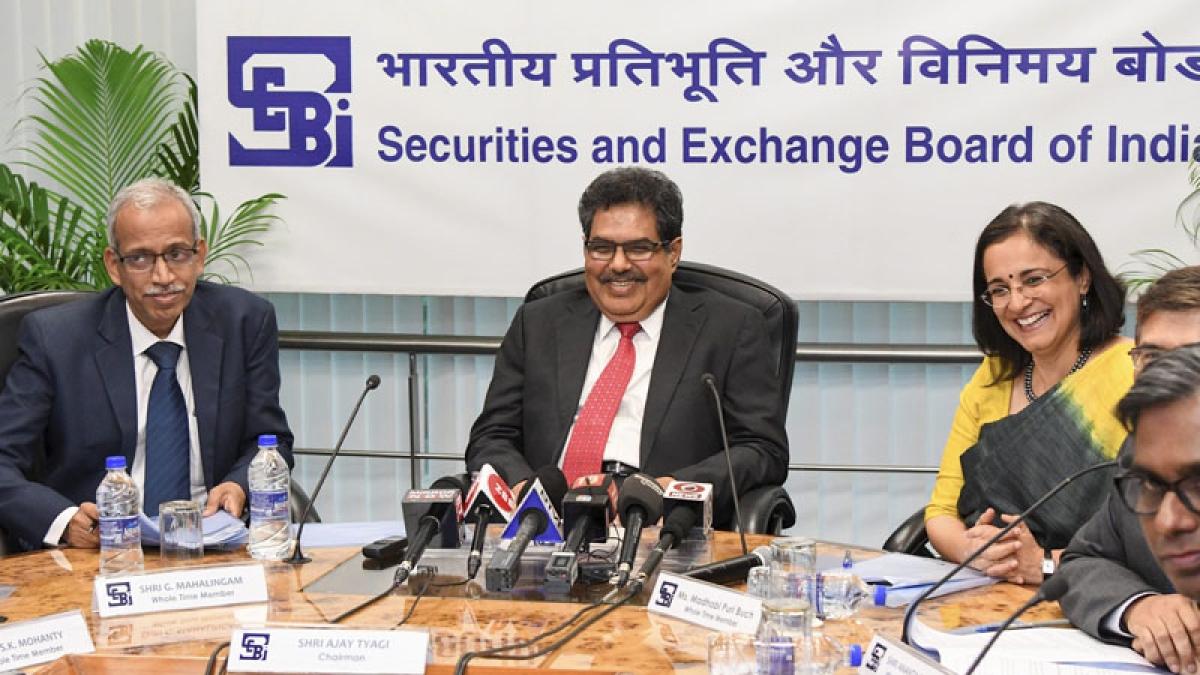 Mumbai: SEBI Chairperson Ajay Tyagi flanked by members G Mahalingam (L), and Madhuban Buch during the SEBI Board meeting at their headquarters, in Mumbai, Tuesday, Sept 18, 2018. (PTI Photo/Shirish Shete) (PTI9_18_2018_000168B)