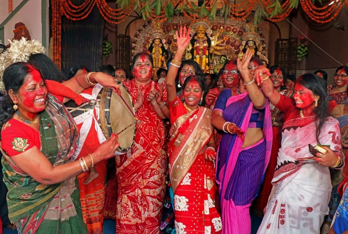 Hindu married women dance during Sindur Khela (applying vermilion) on Bijoya Dashami following Navratri celebrated in October-November every year