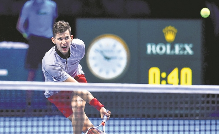 Austria's Dominic Thiem returns against Japan's Kei Nishikori during their men's singles round-robin match on day five of the ATP World Tour Finals tennis tournament at the O2 Arena in London on November 15, 2018. (Photo by Glyn KIRK / AFP)