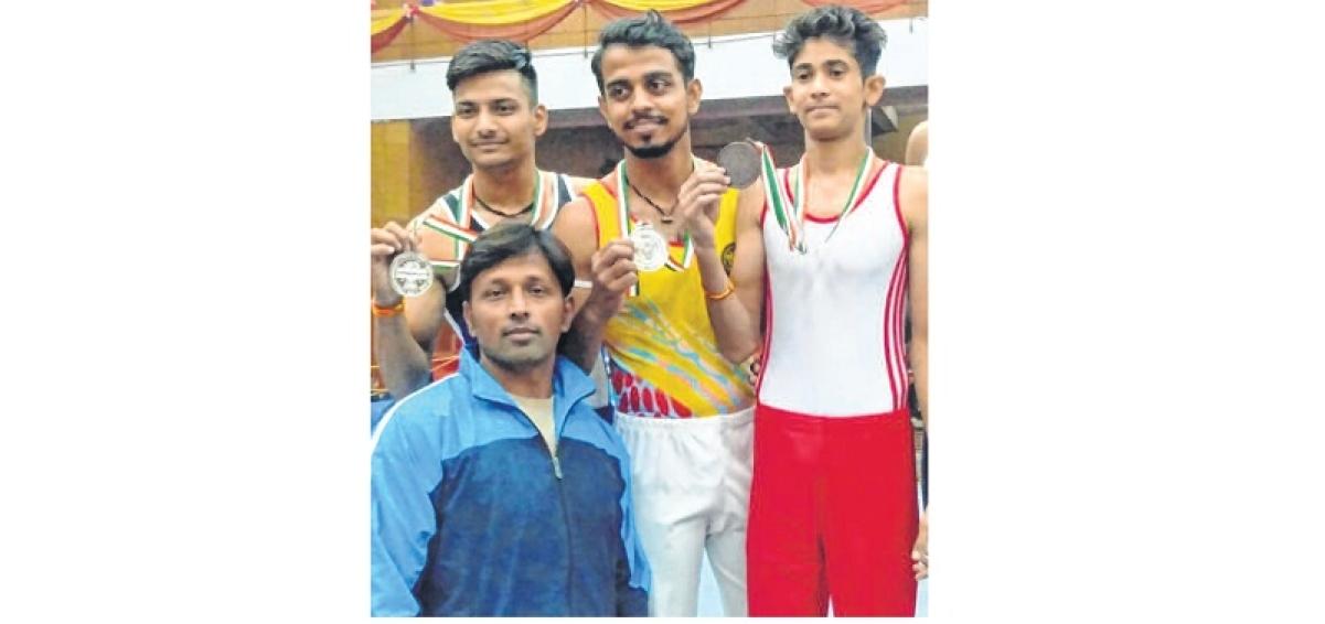 Vikram University's gymnasts clinch silver, bronze