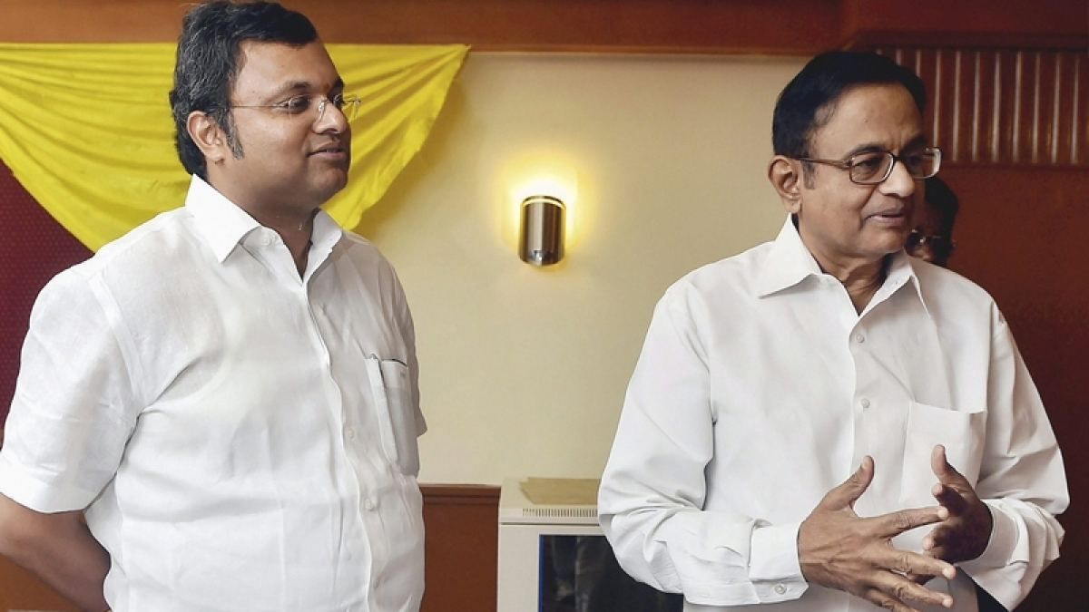 Former Union minister P. Chidambaram (R) and his son Karti