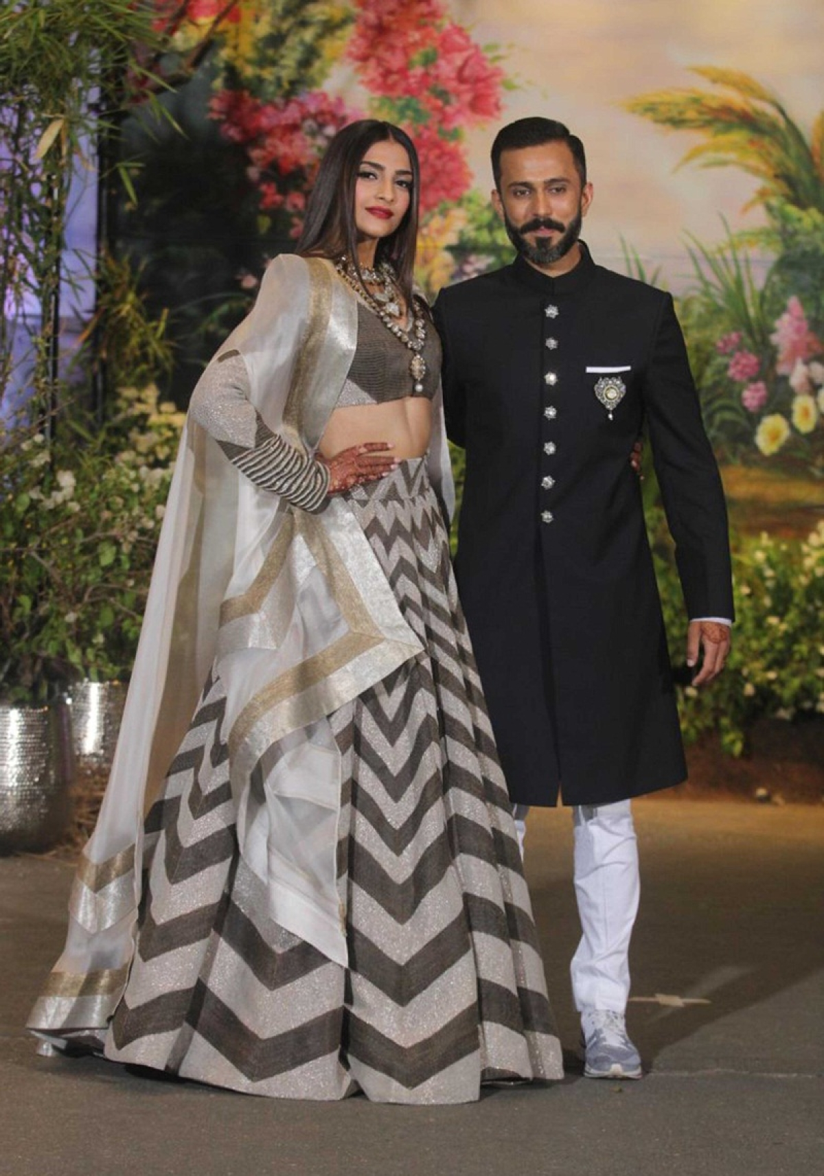 Mumbai : Actress Sonam Kapoor with husband Anand Ahuja during their Wedding<br />Reception at Leela Hotel in Mumbai on Tuesday night . Photo by BL SONI