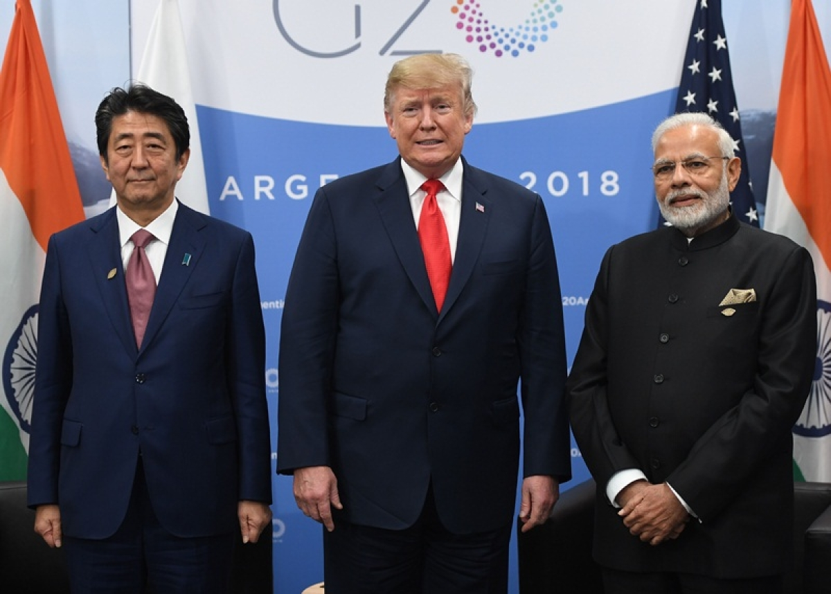 (L to R) Japan's Prime Minister Shinzo Abe, US President Donald Trump and India's Prime Minister Narendra Modi. (Photo by SAUL LOEB / AFP)