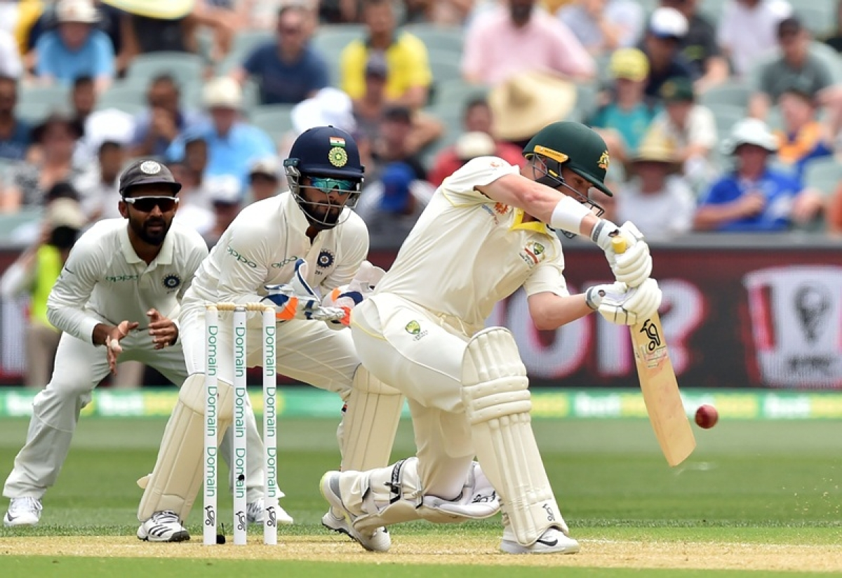 Australia's batsman Marcus Harris (R) plays a shot as Indian wicketkeeper Rishabh Pant (C) looks on during day two of the first Test match at the Adelaide Oval on December 7, 2018. (Photo by PETER PARKS / AFP) / -- IMAGE RESTRICTED TO EDITORIAL USE - STRICTLY NO COMMERCIAL USE --