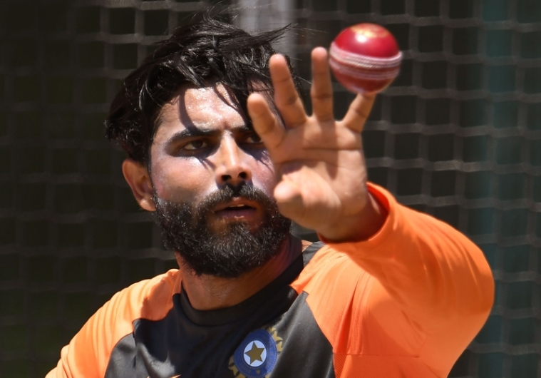 India's all-rounder Ravindra Jadeja catches a ball during a training session in Melbourne. Photo by William WEST / AFP