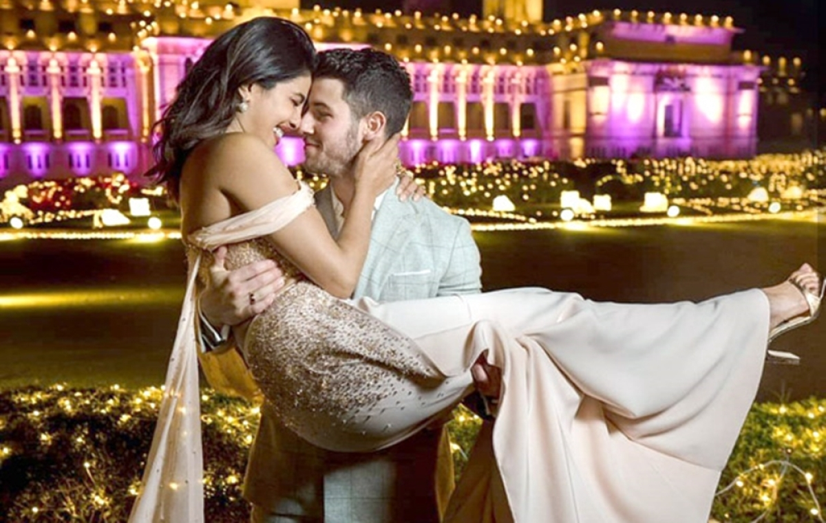 Nick Jonas had an armful of Priyanka Chopra at their pre wedding; see pic