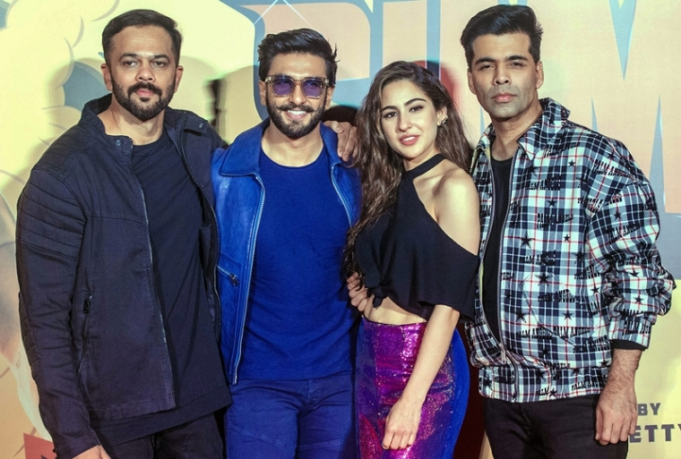 Rohit Shetty, actors Ranveer Singh, Sara Ali Khan and director Karan Johar pose during the trailer launch of film 'Simmba'. PTI Photo