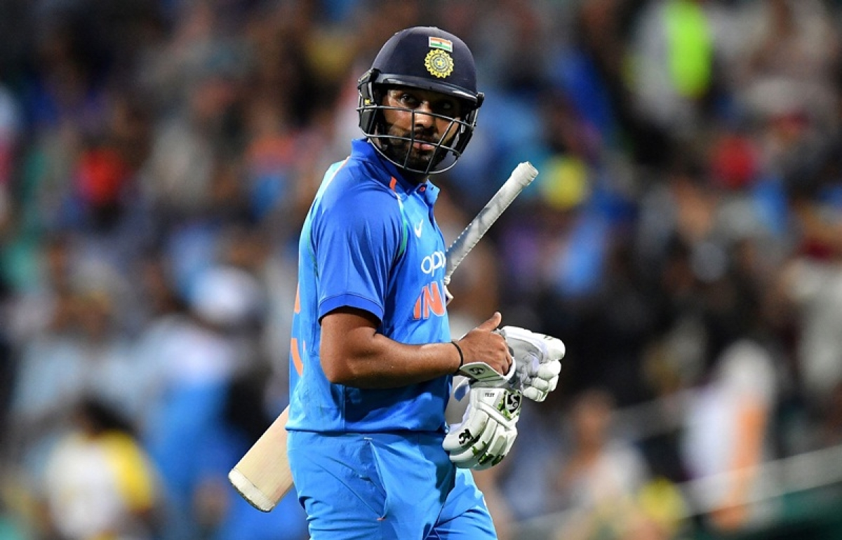 India's batsman Rohit Sharma walks back to the pavilion after his dismissal during the first one-day International (ODI) match between Australia and India at the Sydney Cricket Ground in Sydney on January 12, 2019. (Photo by Saeed Khan / AFP) / -- IMAGE RESTRICTED TO EDITORIAL USE - STRICTLY NO COMMERCIAL USE --