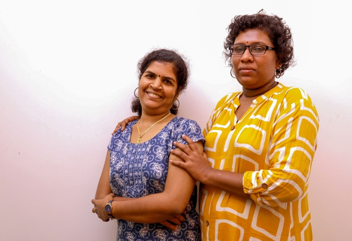 Bindu Ammini (R) and Kanakadurga (L). (Photo by STR / AFP)