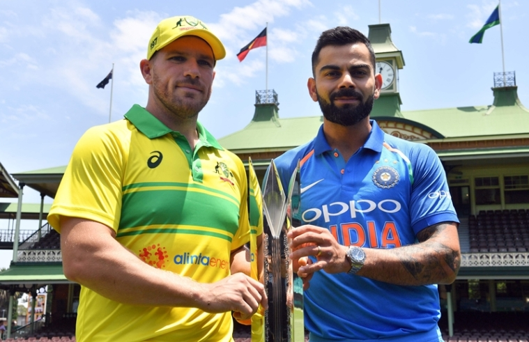 India's cricket team captain Virat Kohli (R) and his Australian counterpart Aaron Finch pose with the ODI series trophy. Photo by SAEED KHAN / AFP