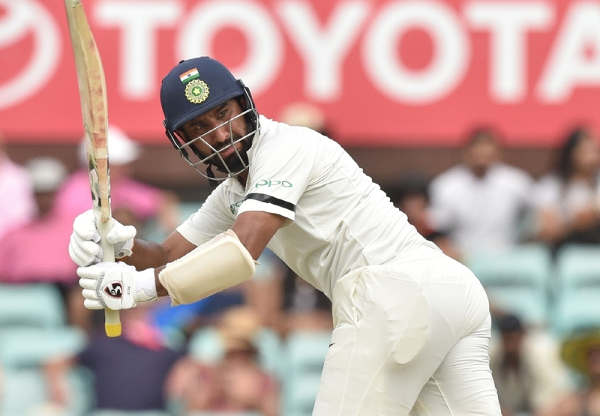 Cheteshwar Pujara plays a shot against Australia during the first day of the fourth and final cricket Test at the Sydney Cricket Ground. Photo by PETER PARKS / AFP