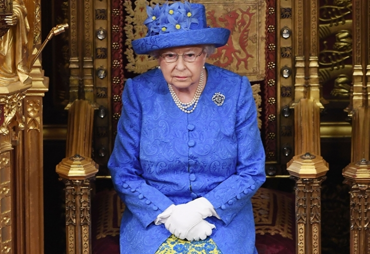 In this file photo Britain's Queen Elizabeth II attends the State Opening of Parliament in the House of Lords at the Houses of Parliament in London Photo by Carl Court / POOL / AFP