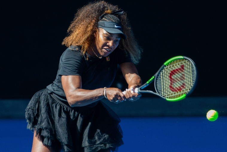 Serena Williams plays a backhand shot during a practice session in Melbourne ahead of the Australian Open. Photo by ASANKA BRENDON RATNAYAKE / AFP