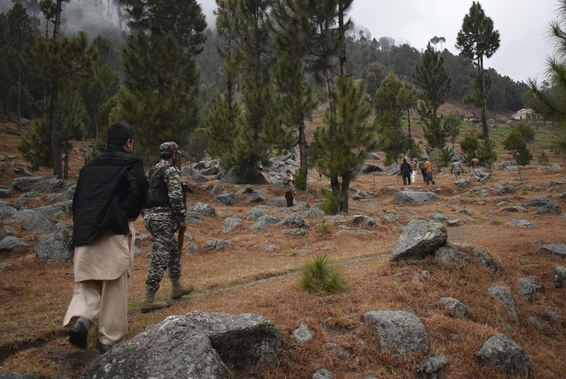 Pakistani reporters and troops visit the site of an Indian airstrike in Jaba, near Balakot, Pakistan.