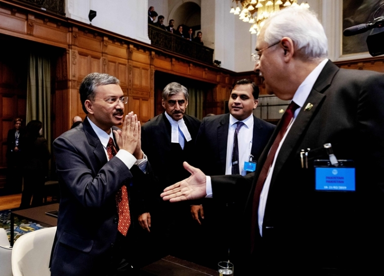 Secretary of Foreign Affairs of India Deepak Mittal (L) and Attorney General of Pakistan Anwar Mansoor Khan (R) greet each other at the International Court of Justice in The Hague. Photo by Robin van Lonkhuijsen / ANP / AFP / Netherlands OUT