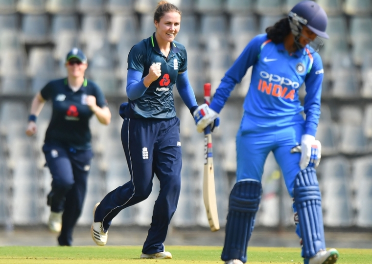 Natalie Sciver (C) reacts after taking the wicket of Harleen Deol during the first match of the women's ODI at the Wankhede Stadium. Photo by Indranil MUKHERJEE / AFP