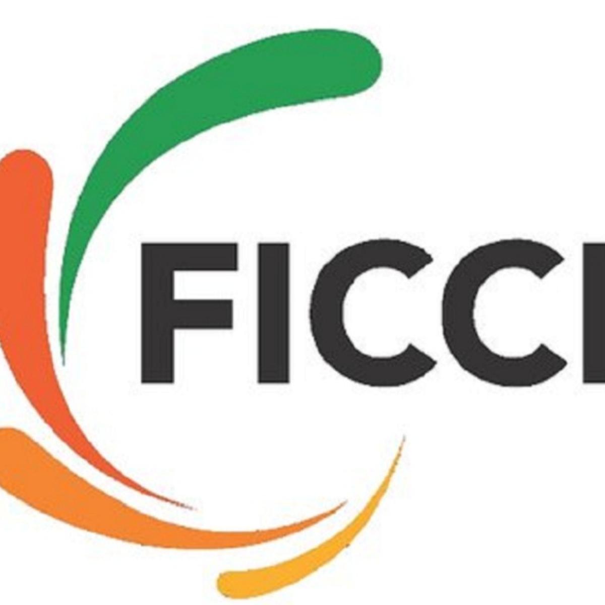 Ficci for increasing FDI cap in insurance to 74 pc