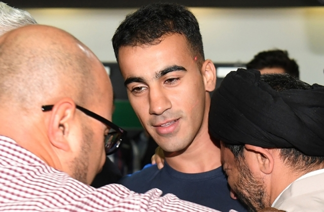 Supporters receive footballer Hakeem al-Araibi (C) upon his arrival at the airport in Melbourne on February 12, 2019. Photo by WILLIAM WEST / AFP