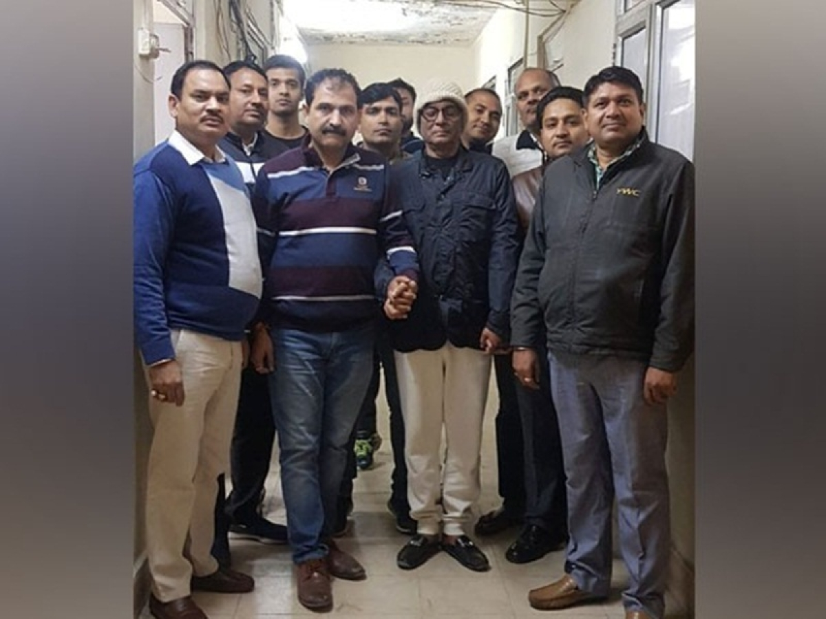 Delhi Police Crime Branch arrests owner of Hotel Arpit Palace Rakesh Goel (Centre, in glasses). Photo by ANI.
